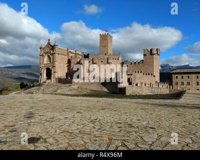 The brick made medieval Javier castle during a sunny cloudy day in Navarre region in Spain - Stock Photo