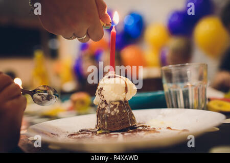 Cupcake With Chocolate Butter Cream And A Burning Candle