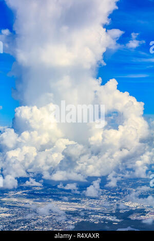 Aerial view of a large and fluffy cumulous cloud above the Miami International Airport in Florida - Stock Photo