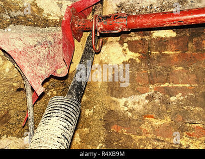 Building of lines of metallic and fiber optic cables of communication network connection.  The trench carries the conduits for gas water electric sewa - Stock Photo