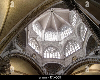 The main dome with stained glass windows and decorated pointed arches inside the gothic Saint Mary's Cathedral in Valencia, Spain - Stock Photo