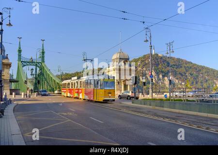 Tram crossing Szabadság híd - Independance or Liberty Bridge in Budapest - Stock Photo