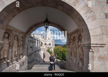 Budapest - tourists explore the Halászbástya or Fisherman's Bastion - Stock Photo