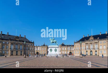 Amalienborg Palace (Amalienborg Slot) with the statue of Frederick V in the centre, Amalienborg Slotsplads, Royal Quarter, Copenhagen, Denmark - Stock Photo