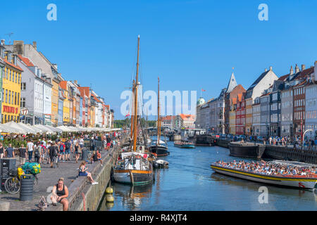 Nyhavn, Copenhagen. Crowded waterfront along the Nyhavn canal, Copenhagen, Denmark - Stock Photo