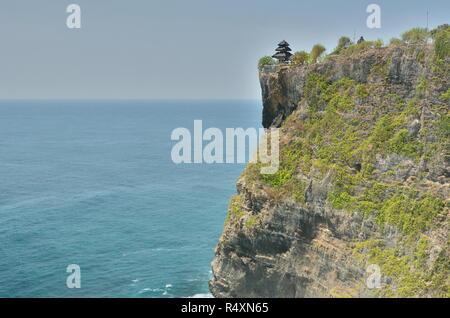 The temple at the edge of the cliff. Pura Luhur Uluwatu. Bali. Indonesia - Stock Photo