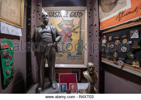 Santa Clara, Cuba: Small Vladimir Ilich Lenin statue and other antiques in the 'Cafe Museum Revolucion' which is a famous place in the central city - Stock Photo