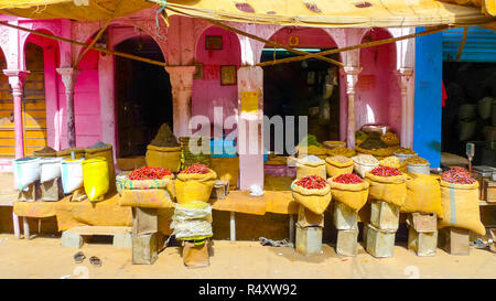 Sacks of chilis, pasta and other ingredients in a kiosk on a street in Bikaner, Rajasthan, India - Stock Photo
