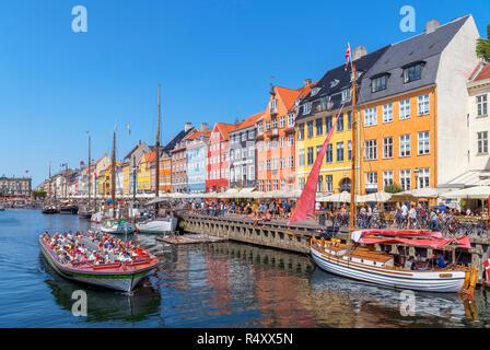 Nyhavn, Copenhagen. Canal tour boat on the Nyhavn canal, Copenhagen, Denmark - Stock Photo