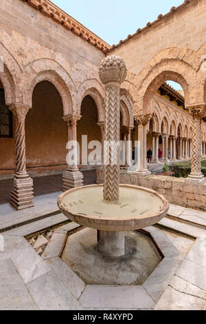 A column carved as a palm tree functions as a fountain, in the Benedictine Cloister of Monreale Cathedral, Sicily, Italy. - Stock Photo