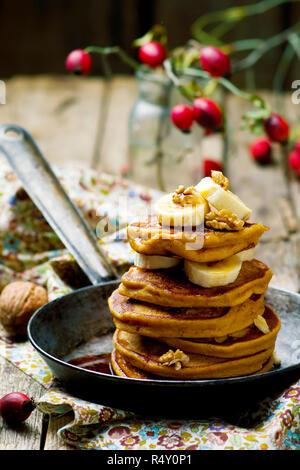 Pumpkin pancakes with banana  .rustic style .selective focus - Stock Photo