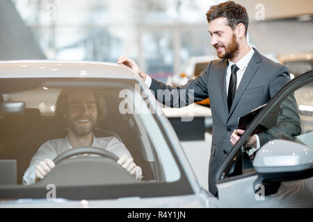 customer looking at cars at dealership and talking to salesperson stock photo 108217101 alamy. Black Bedroom Furniture Sets. Home Design Ideas