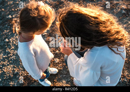Mum and daughter having fun together outdoors. - Stock Photo