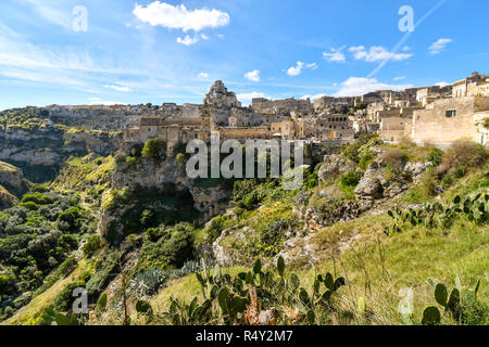 The steep cliffs and canyons and the ancient Madonna de Idris rock church in the city of Matera, Italy, in the Basilicata region. - Stock Photo