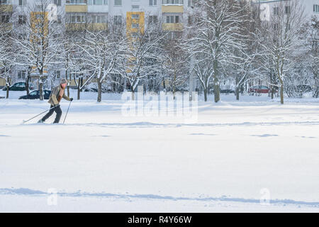 Minsk, Belarus-January 15, 2017: An elderly man runs on skis. Winter fitness. Amateur Cross-Country Skiing - Stock Photo