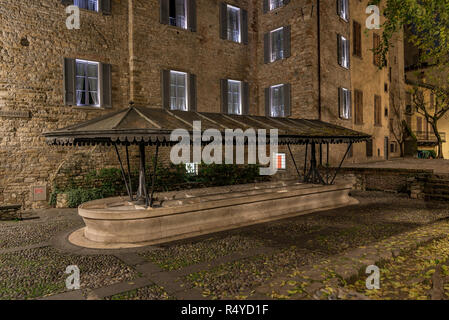 Ancient public wash-house in via Lupo in Bergamo Alta, horizontal night image in the Upper Town - Stock Photo
