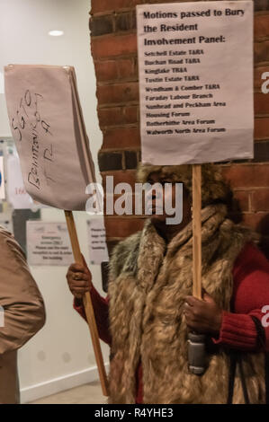 London, UK. 28th November 2018. Southwark council estate residents lobby councillors going in to a council meeting. They call for and end to council estate demolitions and the social and ethnic cleansing of the borough and want on the council to work with residents who it is increasingly disempowering and refusing to listen to. Among the protesters were some from the Aylesbury estate, already part demolished despite a majority ballot calling for refurbishment rather than demolition. Credit: Peter Marshall/Alamy Live News - Stock Photo