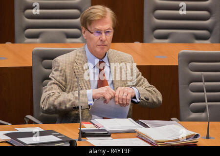 29 November 2018, North Rhine-Westphalia, Düsseldorf: Peter Biesenbach (CDU), Minister of Justice of North Rhine-Westphalia, sits in the plenum of the state parliament. MEPs debate the UK's exit agreement with the EU and the establishment of a committee of inquiry into the death of an innocent Syrian prisoner in the Kleve prison. Photo: Rolf Vennenbernd/dpa Stock Photo