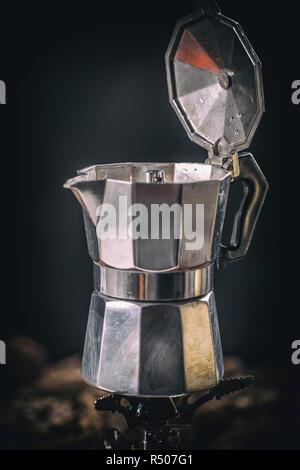 Moka coffee pot on stove - Stock Photo