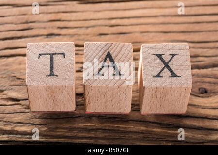 Tax Wooden Blocks - Stock Photo