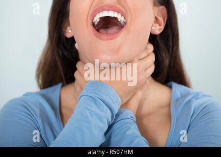 Woman Having Asthma Attack - Stock Photo