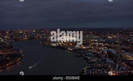 Beautiful London Riverside Skyline and Cityscape Aerial Night View feat. River Thames, The O2 Arena - Millennium Dome is large entertainment district  - Stock Photo