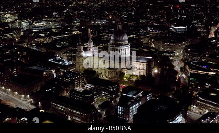 Aerial Night View of St. Paul's Cathedral in London. Birds Eye View Video feat. Religious Iconic Church and Tourism Landmark with traffic in London - Stock Photo