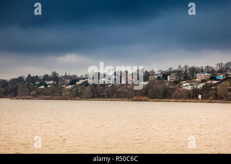 Beautiful houses and beaches on the banks of Elbe river in Hamburg on a cold end of winter day - Stock Photo