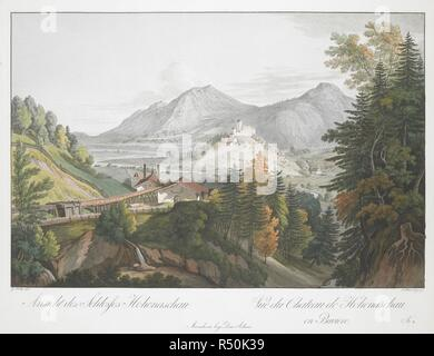 A mining village surrounded by forests near the town of Aschau im Chiemgau in the foreground, with Hohenaschau Castle on top of a hill and mountains in the background . Ansicht des Schlosses Hohenaschau = Vue du Chateau de Hohenaschau en Baviere. Mannheim : bey Dom. Artaria, [about 1802]. Hand-coloured etching and aquatint. Source: Maps 7.Tab.64. Language: German and French. - Stock Photo