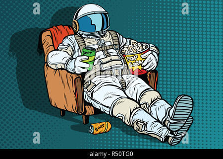 Astronaut the audience with beer and popcorn sitting in a chair - Stock Photo