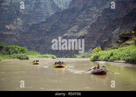 People in rafts and rowboats on Green River on Desolation/Gray Canyon section, Utah, USA - Stock Photo