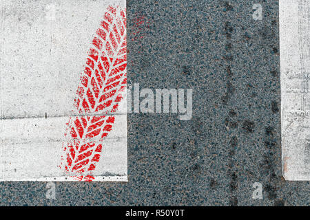 Red car tire marking on pedestrian crossing traffic accidents and safety concept - Stock Photo