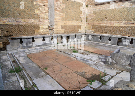 Ostia antica in Rome, Italy. Roman public latrine found in the excavations of Ostia Antica - Stock Photo