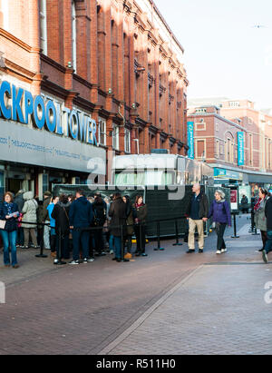 Television vans at Blackpool Tower for transmission of Strictly Come Dancing from the Tower Ballroom with people queueing to enter the Tower Buildings - Stock Photo