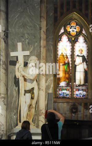 Renaissance statue of Cristo della Minerva (Risen Christ) by Michelangelo in Gothic Basilica di Santa Maria sopra Minerva (Basilica of Saint Mary abov - Stock Photo