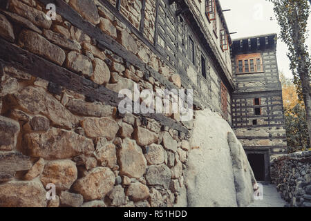 Structure of the ancient stone wall shows timber insert into the wall to support the building. Shigar fort, Pakistan. - Stock Photo