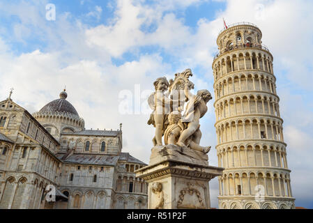 Putti Fountain and Leaning Tower in Pisa, Italy - Stock Photo