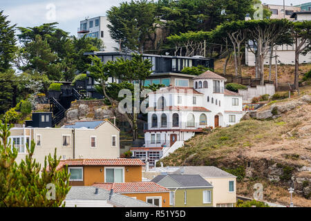 Houses built on one of the steep hills of San Francisco, Golden Gate Heights neighborhood, California - Stock Photo