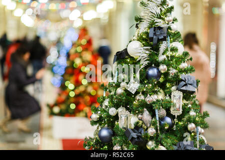 Image of decorated Christmas spruce in store . - Stock Photo