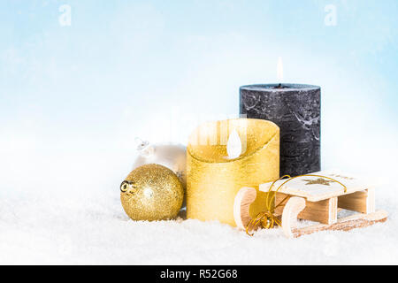 Christmas background. Silver and golden decorations in snow. - Stock Photo