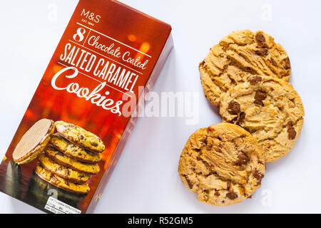 open packet of M&S 8 Chocolate Coated Salted Caramel Cookies with cookies removed set on white background - Stock Photo
