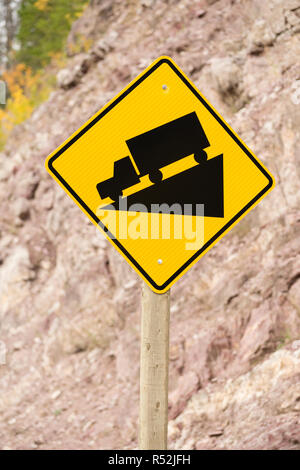 Yellow Square Road Sign Warning Steep Decline Ahead - Stock Photo