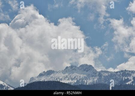 view from aschau on the kampenwand in the snow,priental,chiemgau,upper bavaria,southern germany - Stock Photo