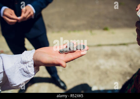 Hand injured bloody finger holds banknote grey background. Dirty money concept. Bloody currency. Money covered with traces of crime. Handover criminal profit. Dollar marked by murder. - Stock Photo
