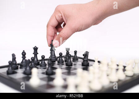 Man is playing chess. Isolated on the white background. - Stock Photo