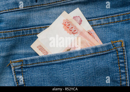 Jeans pocket with banknotes of five thousand Russian rubles. - Stock Photo