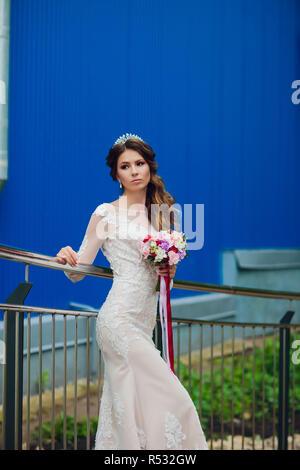 e7c80427e1 Bride Woman with White Wedding Veil  Elegant bride with wedding flowers  bouquet