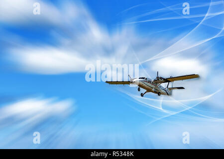 Flying small passenger propeller aircraft in the streams of air. Mixed media - Stock Photo
