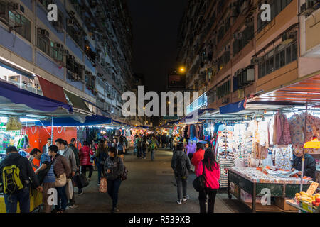 Night view of Fa Yuen street market in Mong Kok, very popular for cheap clothing stalls and stores. Hong Kong, Kowloon, January 2018 - Stock Photo