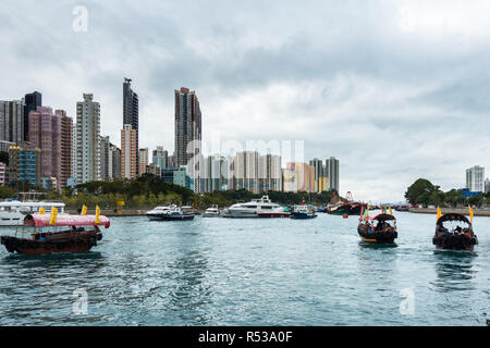 Sampan ride is a popular tourist activity to explore Aberdeen habour and the floating village where people live on house boats, Hong Kong - Stock Photo
